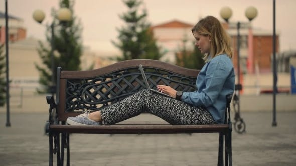 Thumbnail for Businesswoman Working On Laptop On Bench In Park