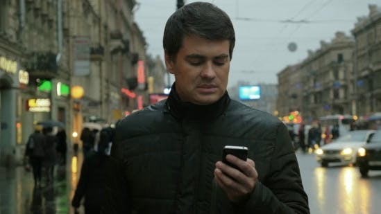 Thumbnail for Man Using Smartphone On The Street