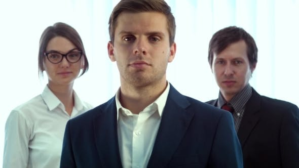 Thumbnail for Team Of Three Successful Business People Looking