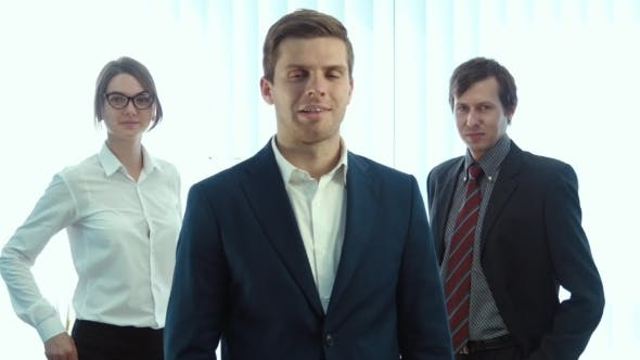 Thumbnail for Team Of Three Successful Business People Looking On Camera