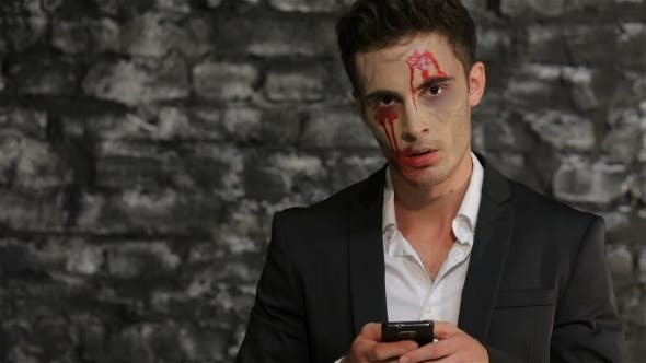 Thumbnail for Male Vampire Uses a Smartphone