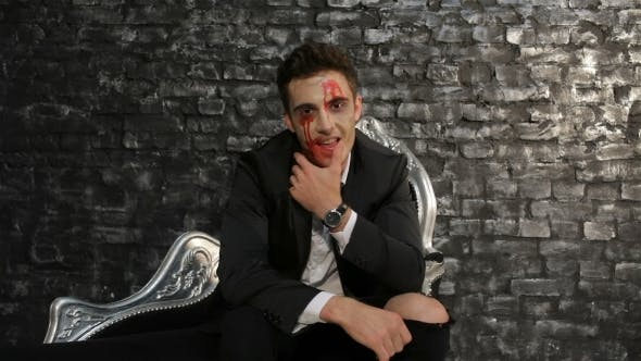 Thumbnail for Male Vampire Sitting On a Black Sofa