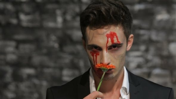 Thumbnail for Male Vampire Smelling a Flower