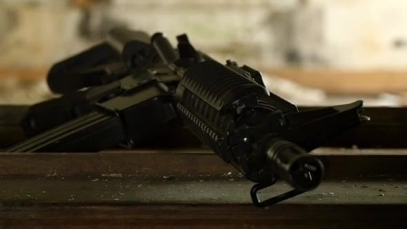 Terrorist Takes His Weapon