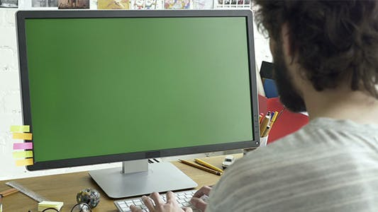Thumbnail for Using Computer With Green Screen Display