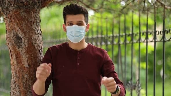 The young male in a medical mask