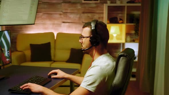 Professional Gamer Concentrated on Shooter Game