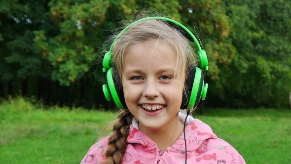 Cover Image for Girl Listening Music With Headphones
