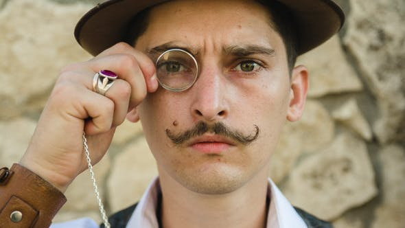 Thumbnail for A Man In A Hat With A Mustache And Monocle
