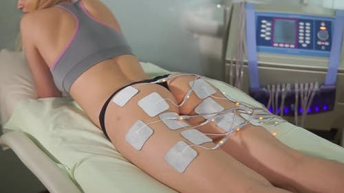Woman Getting Electro Stimulation Therapy of the Butt