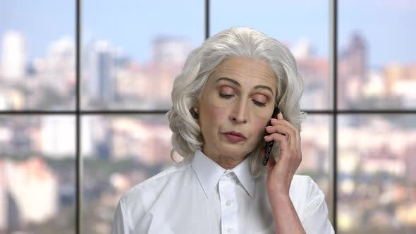 Mature Business Woman Talking on Cell Phone