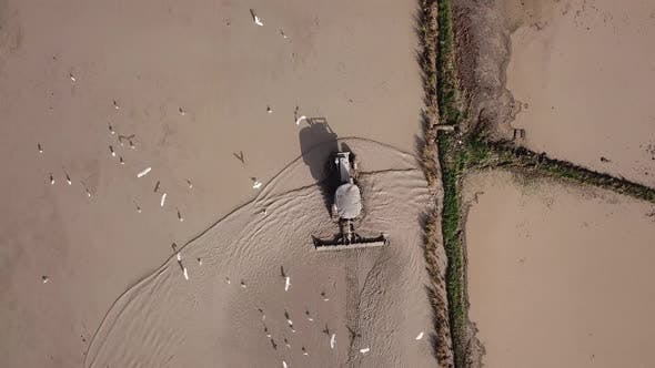Thumbnail for Aerial tractor prepare paddy for cultivation at Malaysia