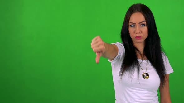 Thumbnail for Young Pretty Woman Disagrees (Show Thumb Down) - Green Screen - Studio