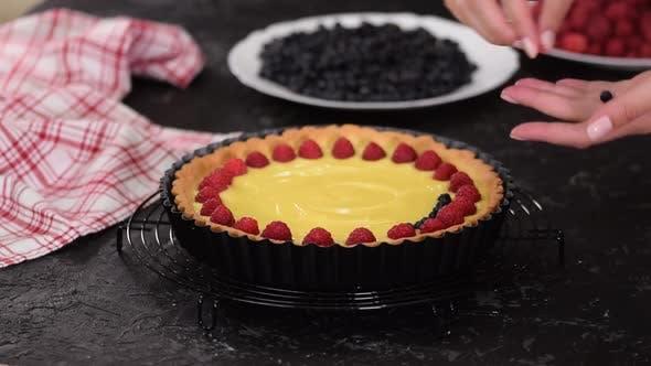 Thumbnail for Woman Making Custard Torte mit Beeren, Torte mit Beeren