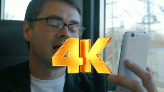 Thumbnail for Businessman Talks On Skype Using Smartphone