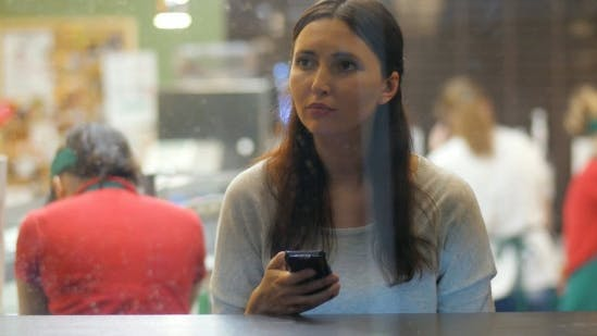 Thumbnail for Young Brunette Girl Using Smartphone In The Cafe