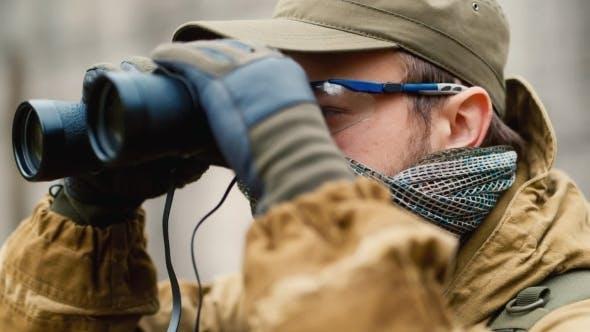 Thumbnail for Man In Camouflage Looking Through Binoculars