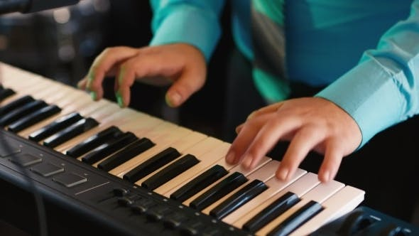 Thumbnail for Hands Of The Musician Playing On a Synthesizer, An
