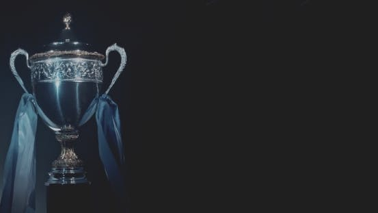 Thumbnail for Champion Silver Trophy On Black Background
