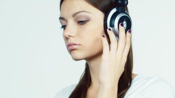 Thumbnail for Dark-haired Girl With Headphones In The Flirting