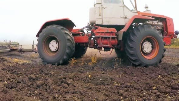 Thumbnail for Tractor With Raised Trailer For Cultivation