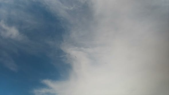 Thumbnail for Clouds Moving In The Blue Sky