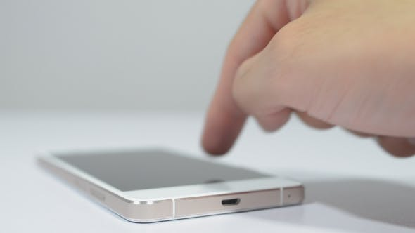 Thumbnail for Using Smartphone on Table