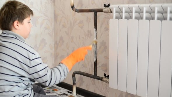 Thumbnail for Boy Paints a Heating Radiator In  Apartment
