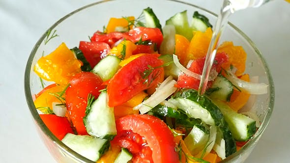 Thumbnail for Vegetable Salad With Olive Oil Pouring From Bottle