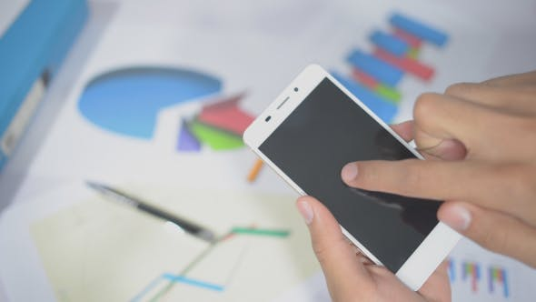 Thumbnail for Using Smartphone in Office