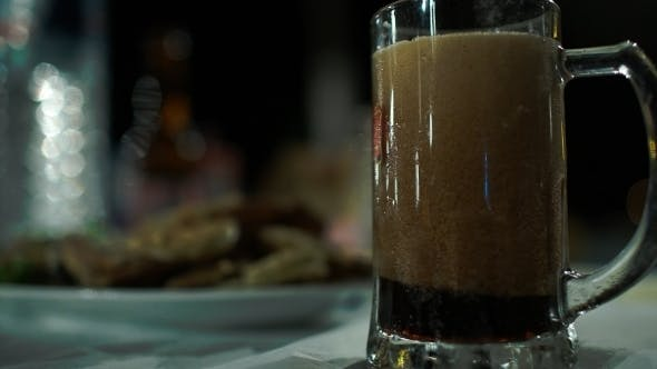 Thumbnail for Pouring Dark Beer Into Glass Mug