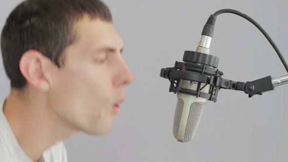 Thumbnail for Man Singing At Studio Microphone.