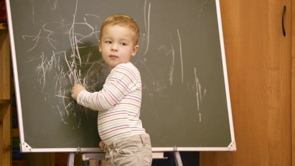 Thumbnail for Creative Little Boy Drawing On a Chalkboard
