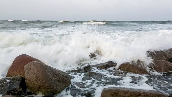 Cover Image for Waves And Foam On Rocky Beach
