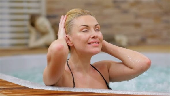 Thumbnail for Young Woman Relaxing In The Water