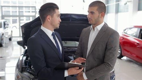 Salesman In a Motor Show