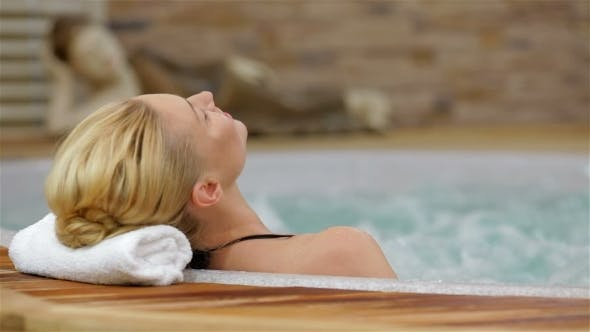 Thumbnail for Back View Of a Woman Enjoying Jacuzzi