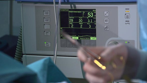 Thumbnail for Surgeon Hands Stitching Up. ECG Monitor.
