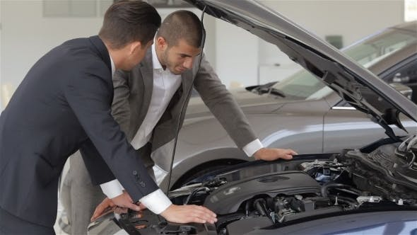 Male With Car Dealer