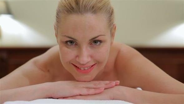 Thumbnail for Woman Looking At Camera While Massage