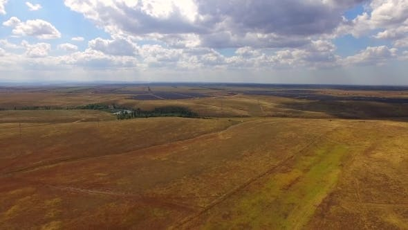 Thumbnail for Aerial Shot Over Agricultural Fields With Solar