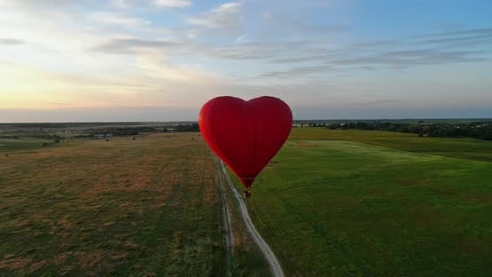 Heart shape aerostat against the setting sun
