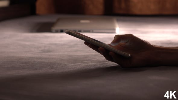 Thumbnail for Typing Email On Smartphone In Bed