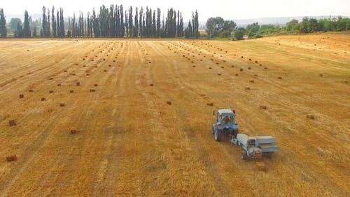 Rural Tractor Baler Standing In Stubble Yellow