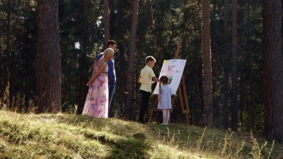 Thumbnail for Kids Drawing Happy Family Picture In The Wood