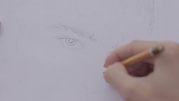Thumbnail for Woman Draws Man's Portrait 2