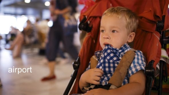 Thumbnail for Young Boy Sitting In a Child Trolley In An Airport