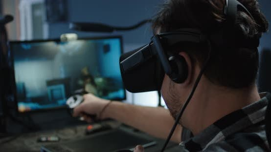 Thumbnail for Developer Playing a VR Game or Simulator