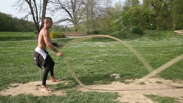 Thumbnail for Trained Muscular Man Exercising With Ropes