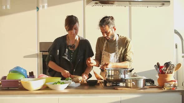 Thumbnail for Young Couple Preparing Lunch In The Kitchen 12